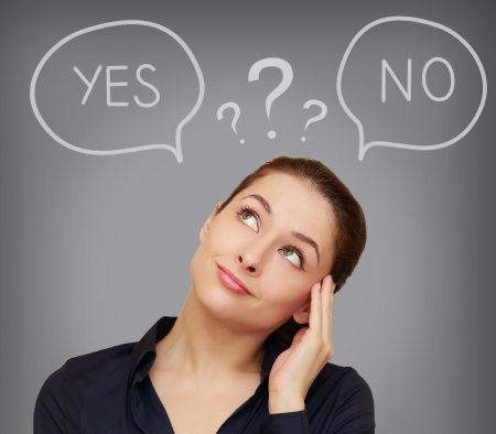 Business thinking woman with yes or on in speech bubble on grey background