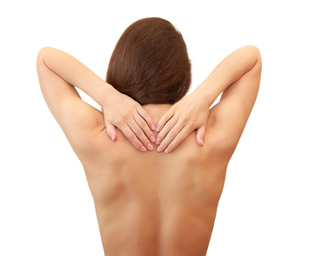 naked woman back: Beautiful woman holding hands her back isolated on white background Stock Photo