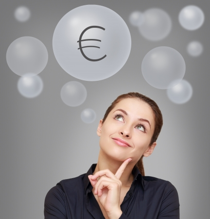 woman looking up: Thinking smiling woman looking up on euro sign in bubble on grey background