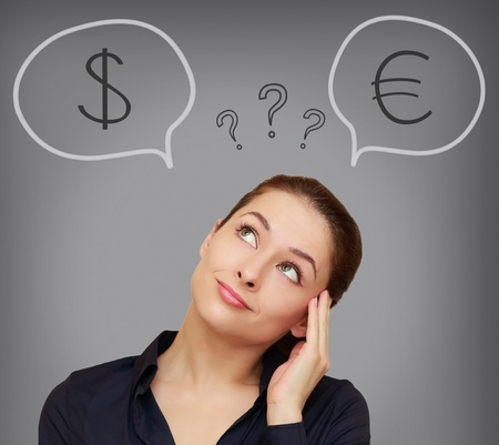 Business woman thinking about euro or dollar currency on grey background photo