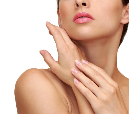 french woman: Beautiful female hand with clean skin near face isolated on white background Stock Photo