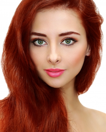 Beautiful female with bright red hair cut  Closeup portrait photo