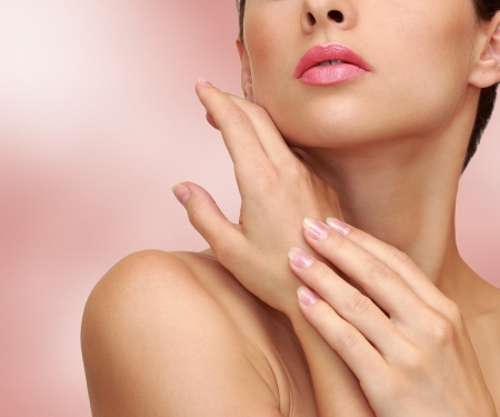 DERMATOLOGY: Beauty woman hands with health skin on pink background Stock Photo