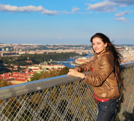 czech women: Happy woman looking on Prague view sunny background from high tower under blue sky in summer day