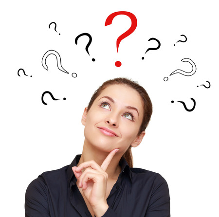 Thinking smiling woman with questions marks above looking up on red sign isolated on white background Stock Photo