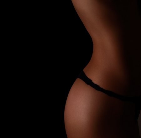 Sexy perfect woman body  Closeup on black background photo