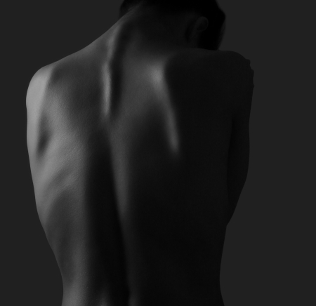 nude woman back: Beautiful woman back on dark background  Black and white portrait Stock Photo