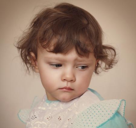 Sad baby girl looking down  Closeup portrait Stock Photo - 24097419
