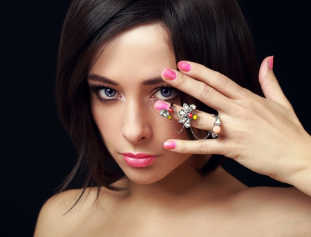 Makeup female model with fashion ring on hand  Closeup portrait photo