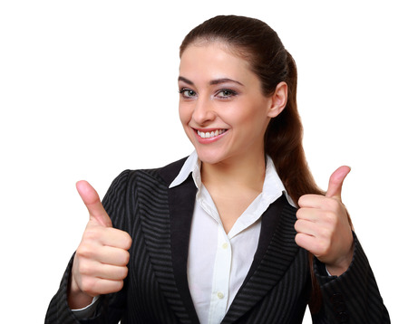 Happy business woman showing hands thumb up sign isolated on white photo