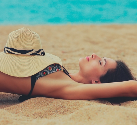 Beautiful woman relaxing on the beach  Closeup portrait photo