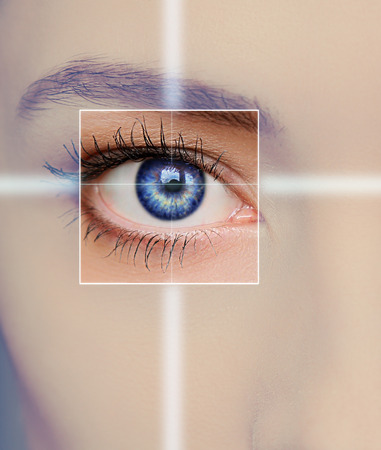 Eye technology, medicine and vision concept  Focus on blue woman eye  Closeup photo