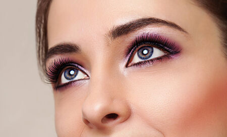 Beauty girl eyes with perfect bright makeup photo