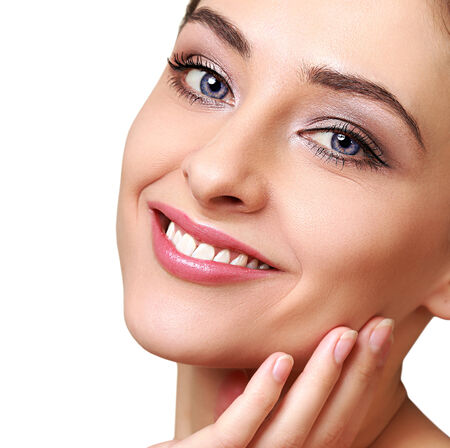 Beauty woman face with clean white teeth isolated photo