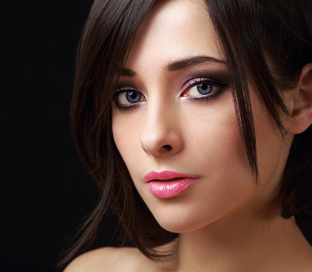 Beautiful perfect makeup woman face with long lashes on black background