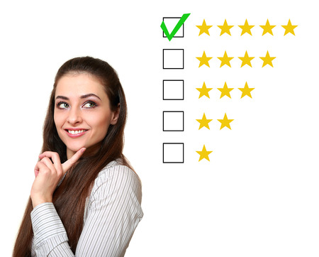 Thinking customer woman choosing five star rating  Good feedback  Isolated on white background Stock Photo