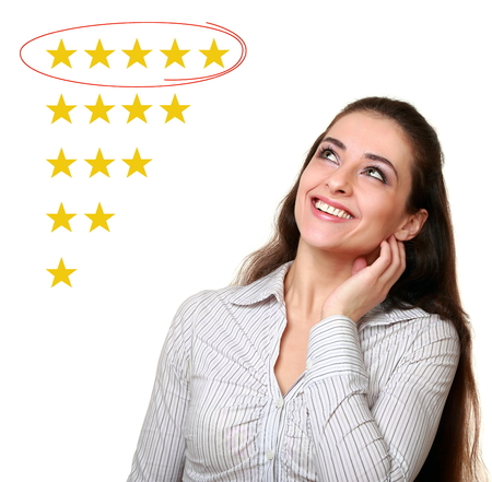 Beautiful woman looking up and choose five stars rating in feedback isolated