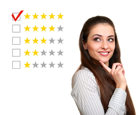 Beautiful woman choose five stars rating in feedback  Good result Stock Photo