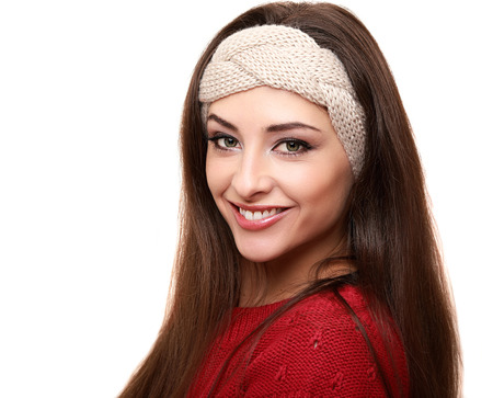Beautiful smiling woman in warm headband isolated on white