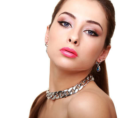 Beautiful makeup woman with necklace isolated on white background photo