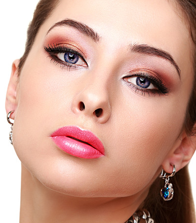 Sexy bright makeup woman face with long lashes  Closeup photo