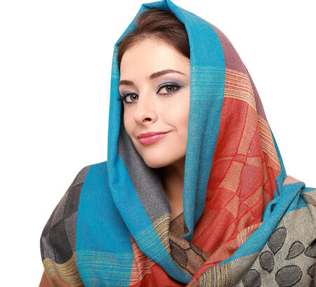 Beautiful makep woman in colorful scarf isolated on white photo