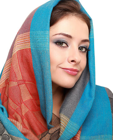Beautiful makep woman in colorful shawl isolated on white  Closeup photo
