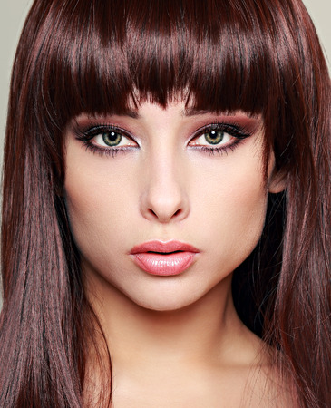 Perfect makeup woman face with green eyes  Closeup photo