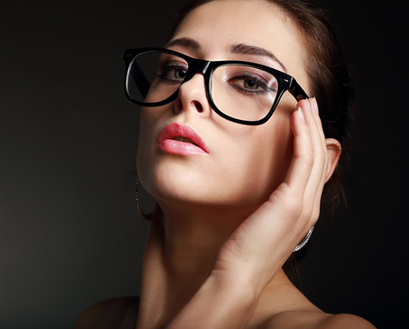 Sexy hot woman in glasses on black background  Closeup photo