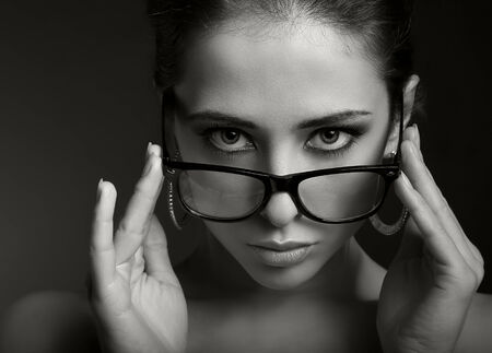 Sexy woman in modern glasses  looking serious  Black and white portrait photo