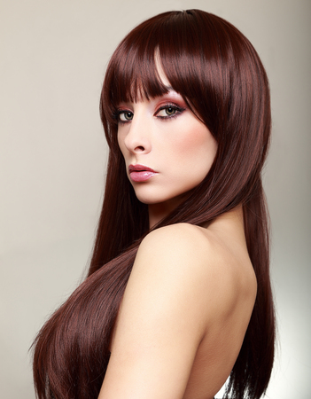 Beautiful makeup woman with perfect brown hair photo