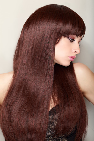 Beautiful profile of woman face with gorgeous long hair photo