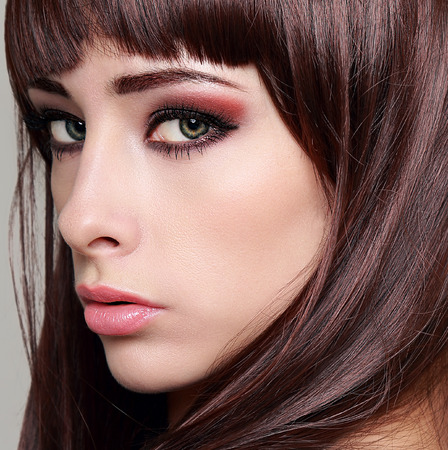 Sexy woman with bright makeup eyes and long lashes  Closeup photo