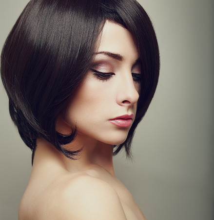 Beautiful elegant female with black short hair  Closeup art portrait photo
