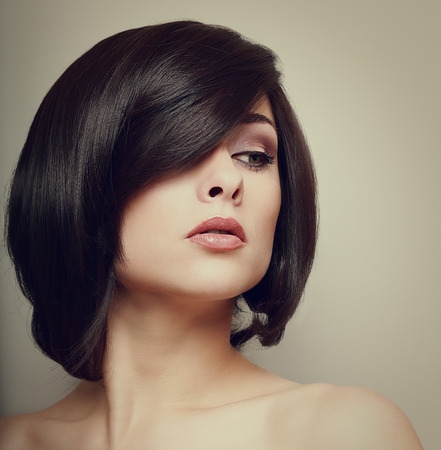 Vintage portrait of beautiful woman  Hair style  Makeup photo