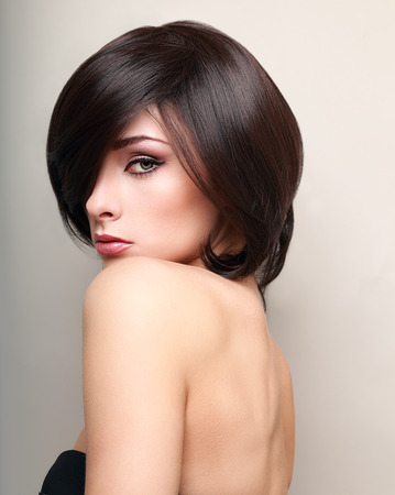 Sexy makeup female model with black short hair  Closeup portrait photo