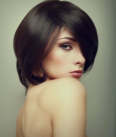 Vogue portrait of alluring woman with short hair style  Closeup photo