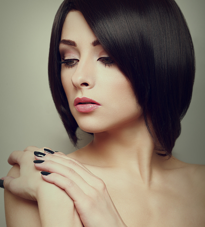 Sexy black short hair style female model looking  Closeup portrait photo