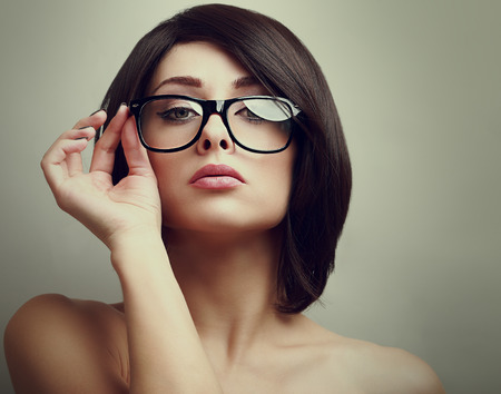 Fashion female model holding the hand glasses  Closeup portrait  photo