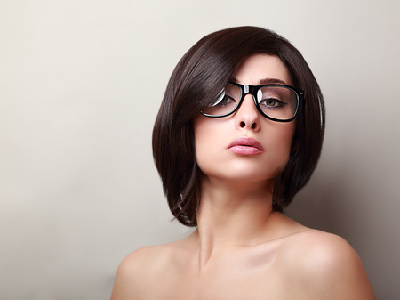 Sexy woman with short hair looking in fashion glasses Stock Photo - 27540658