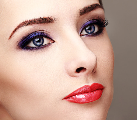 Beautiful woman with bright eyes makeup and long lashes  Closeup photo