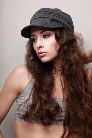 Sexy young woman with long hair in trendy cap  Hipster modern lifestyle Stock Photo - 27571628