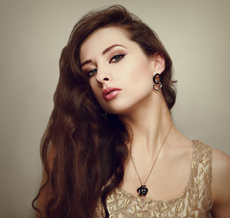Beautiful female model with long hair posing  Closeup portrait photo
