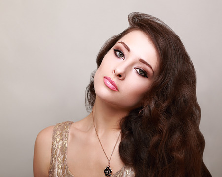 Beautiful bright makeup woman with long healthy brown hair photo