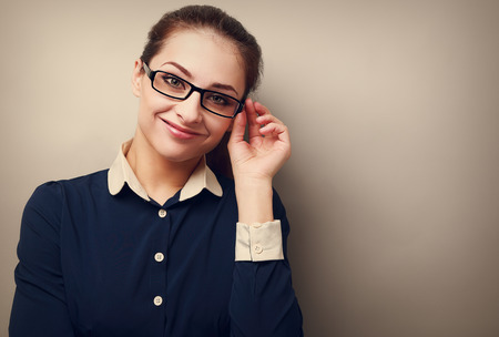Happy business woman in glasses looking on copy space empty background photo