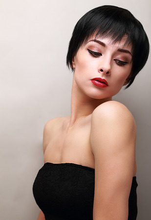 Sexy woman with black short hair styly looking down Stock Photo - 28299714