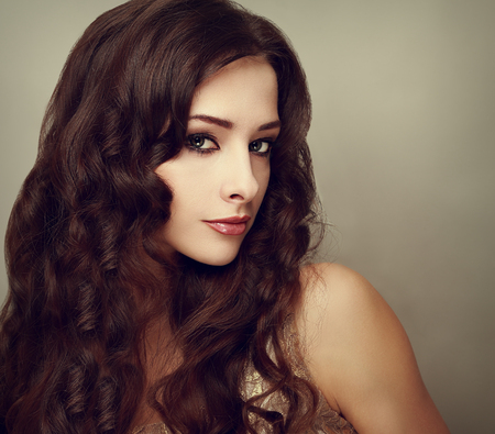 Fashion luxury female model with long curly hair  Vogue vintage portrait photo