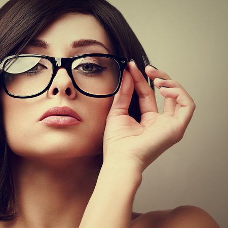 Beautiful sexy woman in fashion glasses looking  Vintage portrait photo