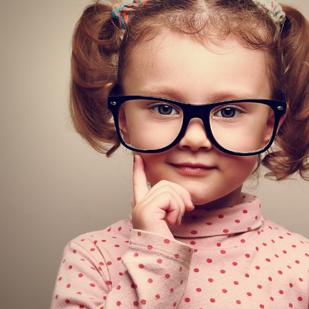 Closeup portrait of fun happy  kid girl in glasses  Vintage Stock Photo - 28880741