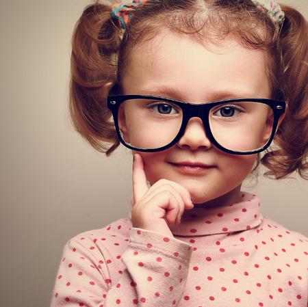 Closeup portrait of fun happy  kid girl in glasses  Vintage Stock Photo - 28880741
